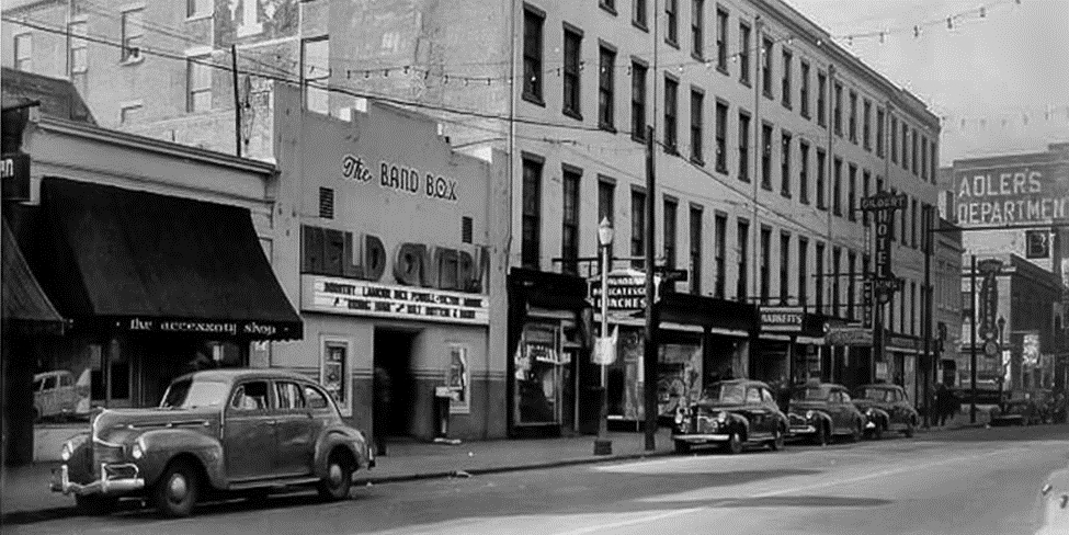 black and white photo showing buildings along a street