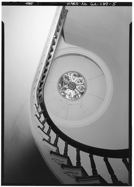 Looking up the spiral staircase at the Mercer House, with the glass dome skylight in the center of the photo